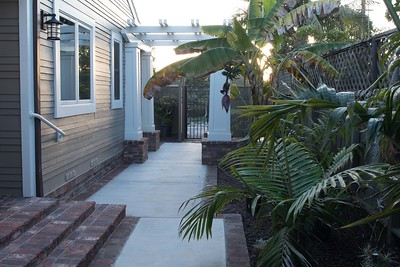 Entry way walk with palms and bananas after remodel 3/03/2015