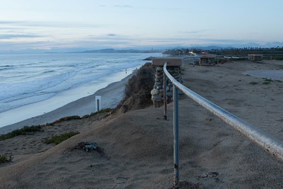 Beach after the storm looking north with San Clemente at the far horizon dropping toward the ocean. 3/02/2015
