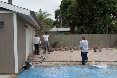 Andy Flores laying out the random pattern for the pavers with helpers.