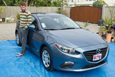 Perry checking out lines on his new car, Mazda 3 Hatchback 5/25/2015